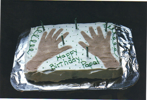 Calvins_hand_prints_on_dads_cake